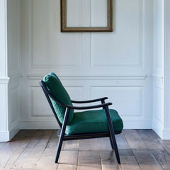 ercol Marino Chair black with green linen in room profile