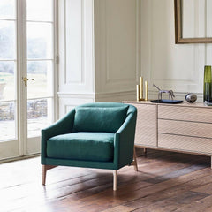 ercol Modulo Storage Cabinet in room with Rho Chair by Matthew Hilton