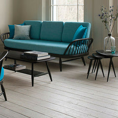 Ercol Originals Studio Sofa Teal with Black Frame in Room with Nesting Tables