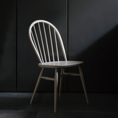 ercol Originals Windsor Chair 1877 in room with black walls