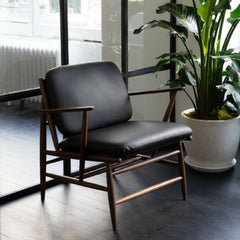 ercol Von Arm Chair by Atlason Walnut with Black Leather in situ