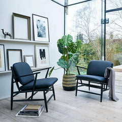 ercol Von armchairs in room