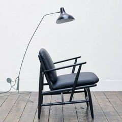 ercol Von Arm Chair in room with Mantis Lamp