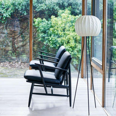 ercol Von armchairs black leather in living room side view