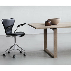 Essay Table in Room with Upholstered Series 7 Chair on Casters Fritz Hansen