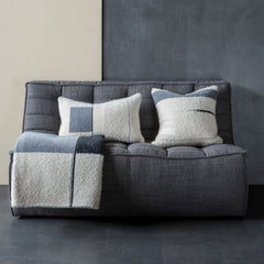 Ethnicraft N701 Sofa Dark Grey in situ with pillows and blanket
