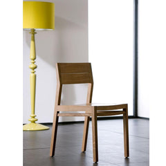 Ethnicraft Ex 1 Chair styled with yellow lamp