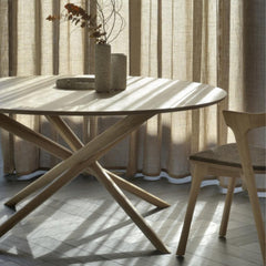 Ethnicraft Round Mikado Dining Table in room with Oak Bok Chair
