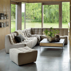 Ethnicraft N701 Sectional Sofa and N701 Ottoman in room with Oak Blackbird Coffee Table