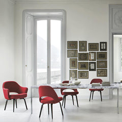Florence Knoll Marble Dining Table in Room with Red Saarinen Executive Chairs