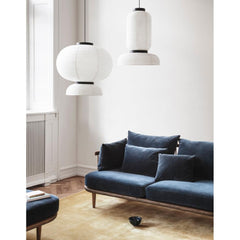 And Tradition JH3 and JH5 Formakami Pendant Lights in room with Fly Sofa by Space Copenhagen