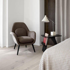 Fredericia Jens Risom Magazine Table in room with petite Swoon lounge chair