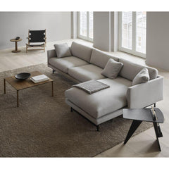 Fredericia Jens Risom Magazine Table in room with Calmo sectional sofa and Piloti coffee table.