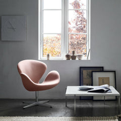 Fritz Hansen Arne Jacobsen Swan Chair Light Pink in room with Poul Kjaerholm Coffee Table