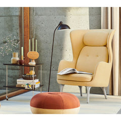 Fritz Hansen Arne Jacobsen Tea Trolley in room with Ro Chair, Kasier Idell Lamp, and Cecilie Manz Pouf