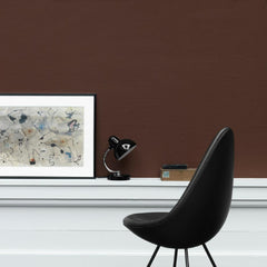 Fritz Hansen Arne Jacobsen Drop Chair Black Leather in room with Art
