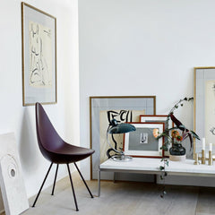 Fritz Hansen Arne Jacobsen Drop Chair styled in room with Art