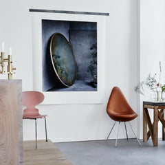 Fritz Hansen Arne Jacobsen Drop Chair in Elegance Walnut Leather in room with Pink Ant Chair