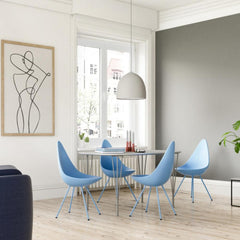 Fritz Hansen Arne Jacobsen Drop Chairs in Blue in Dining Room with Superelliptical Table and Suspence Pendant