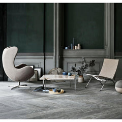 Fritz Hansen Arne Jacobsen Egg Chair in room with Poul Kjaerholm Furniture