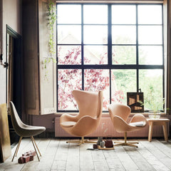 Fritz Hansen Arne Jacobsen Drop Chair 60th Anniversary Edition Profile View in room with Egg and Swan Chairs