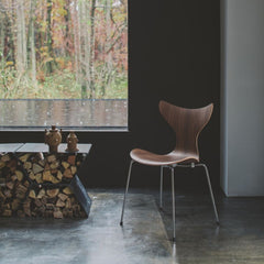 Fritz Hansen Lily Chair 3108 in room with firewood