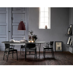 Fritz Hansen Caravaggio Pendant Light with Super Elliptical Table and Nendo N01 Chairs