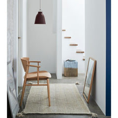 Fritz Hansen Caravaggio Pendant by Cecilie Manz in hallway with Nendo N01 Chair