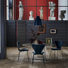 Fritz Hansen Ultramarine Caravaggio Pendant Light by Cecilie Manz with Poul Kjaerholm PK54 Table and Lala Berlin Series 7 Chairs in Caspian