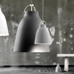 Fritz Hansen Caravaggio Pendant Lights by Cecilie Manz styled in warehouse