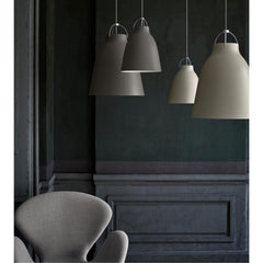 Fritz Hansen Caravaggio Pendant Lights by Cecilie Manz in situ with Swan Chair