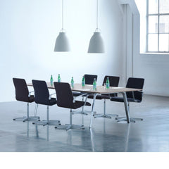 Fritz Hansen Caravaggio Pendant Lights by Cecilie Manz in Conference Room with Oxford Chairs and Pluralis Table