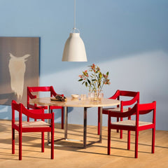 Fritz Hansen Carimate Chairs by Vico Magistretti in room with Poul Kjaerholm Dining Table and Caravaggio Pendant Light