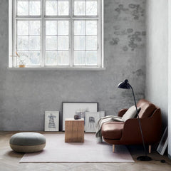 Fritz Hansen Cecilie Manz Pouf in room with Leather Lune Sofa