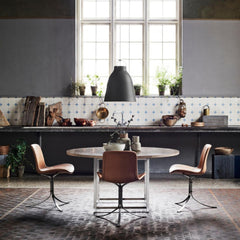Fritz Hansen Caravaggio Pendant with Poul Kjaerholm PK54 Table and PK9 Chairs