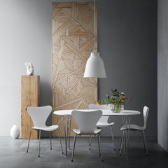 Fritz Hansen White Caravaggio Pendant Light by Cecilie Manz in room with Super Elliptical Table and Series 7 Chairs