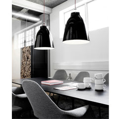 Fritz Hansen Cecilie Manz Caravaggio Pendant Lights Gloss Black in room with Saarinen Organic Conference Chairs