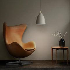 Fritz Hansen Caravaggio Pendant Light in room with Egg Chair