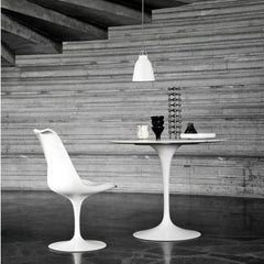 Fritz Hansen Cecilie Manz Caravaggio Pendant Light Gloss White in room with Saarinen Tulip Table and Tulip Chair