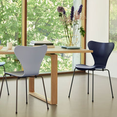 Fritz Hansen Essay Table by Cecilie Manz in room with Series 7 Chairs and Ikebana Vase