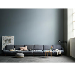 Fritz Hansen Cecilie Manz Pouf in room with Large Lune Sofa and Tray Table
