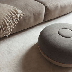 Fritz Hansen Cecilie Manz Pouf Concrete Remix in room with throw