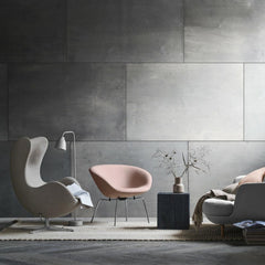 Fritz Hansen Arne Jacobsen Egg and Pot Chairs in room with Lune Sofa