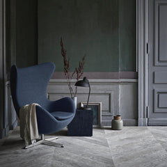 Fritz Hansen Arne Jacobsen Egg Chair Dark Blue in room with Kaiser Idell Lamp