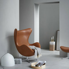 Fritz Hansen Egg Chair in Elegance Leather Walnut in Room with Lightyears Pendant and Objects