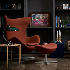 Fritz Hansen Egg Chair in room with Kaiser Idell Luxus Table Lamp and Tray Table