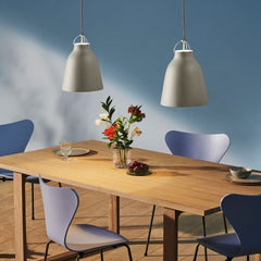Fritz Hansen Essay table with Caravaggio Pendant Lights, Series 7 Chairs, and Ikebana Vase
