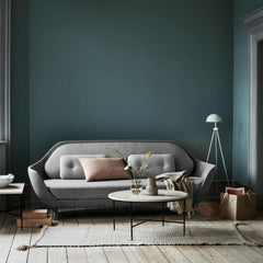 Fritz Hansen Favn Sofa in room with Paul McCobb Planner Coffee Tables