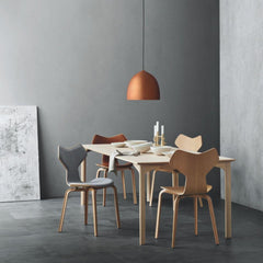 Fritz Hansen Gam Fratesi Suspence Pendant Copper in room with Grand Prix Dining Table and Chairs