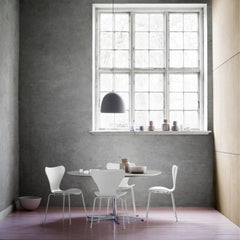Fritz Hansen Gam Fratesi Suspence Pendant Light Grey in room with white Series 7 Chairs